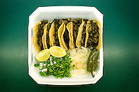 A plate of Carne Asada tacos with fired onions, cilantro, and limes at Cilantros Taqueria in Dallas, Texas, Thursday, September 17, 2009. ..