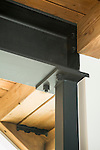 Detail image of exposed metal and wood beams in a contemporary home. This image is available through an alternate architectural stock image agency, Collinstock located here: http://www.collinstock.com