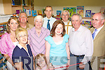 Cromane NS youngest student Emma Carey and oldest Martina O'Sullivan cut the tape to officially open the new library in Cromane NS on Friday l-r: Noreen O'Keeffe, Ann Foley, Sean Roche, Margaret Foley, Sean O'Sullivan, Martina O'Sullivan, Fr Liam O'Brien, Patrick O'Shea and Seamus Shaugnessy Principal.