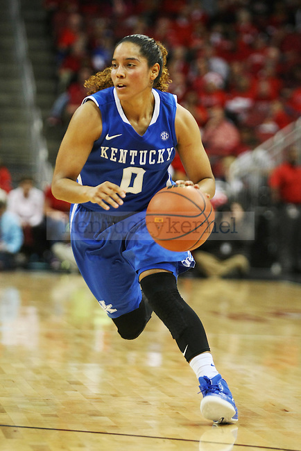 Guard Jennifer O'Neil of the Kentucky Wildcats drives down the court during the second half of the women's basketball game against the Louisville Cardinals at KFC Yum Center on Sunday, December 7, 2014 in Louisville, Ky. Kentucky defeated Louisville for the fourth straight year, 77-68. Photo by Michael Reaves | Staff