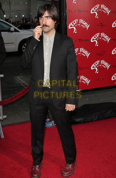 """JASON SCHWARTZMAN.""""Scott Pilgrim Vs. The World"""" Los Angeles Premiere held at The Grauman;s Chinese Theatre, Hollywood, CA, USA..July 27th, 2010.full length suit shirt black white top striped stripes moustache mustache facial hair hand.CAP/ADM/KB.©Kevan Brooks/AdMedia/Capital Pictures."""