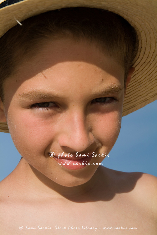 Portrait of a smiling young Caucasian boy at the beach, Cayo Jutias, Cuba.