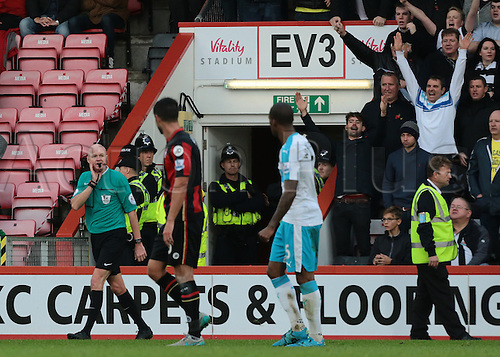 07.11.2015. Vitality Stadium, Bournemouth, England. Barclays Premier League. Referee Lee Mason blows for full time as Newcastle fans celebrate their unliekly win
