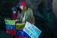 MEXICALI,  MEXICO - January 24. A couple of Venezuelan women hold a Venezuelan flag while participating in a public demonstration supporting Juan Guaido on January 24, 2018 in Mexicali, Mexico. Donald Trump has promptly recognized formerly-unknown Juan Guaigó as interim president of Venezuela. Sec. of State Mike Pompeo announced that the US is ready to provide more than $20,000,000 in humanitarian aid to the people of Venezuela. <br /> (Photo by Luis Boza/VIEWpress)