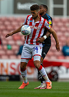 27th June 2020; Bet365 Stadium, Stoke, Staffordshire, England; English Championship Football, Stoke City versus Middlesbrough; Tommy Smith is tackled by Patrick Roberts of Middlesbrough