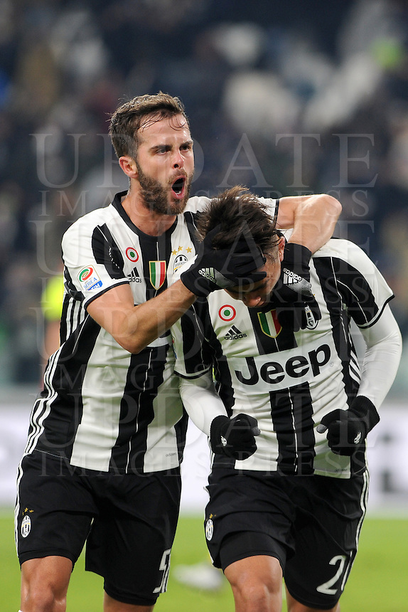 Calcio, Serie A: Juventus vs Bologna. Torino, Juventus Stadium, 8 gennaio 2017.<br /> Juventus' Paulo Dybala, right, celebrates with teammate Miralem Pjanic after scoring on a penalty kick during the Italian Serie A football match between Juventus and Bologna at Turin's Juventus Stadium, 8 January 2017. Juventus won 3-0.<br /> UPDATE IMAGES PRESS/Manuela Viganti