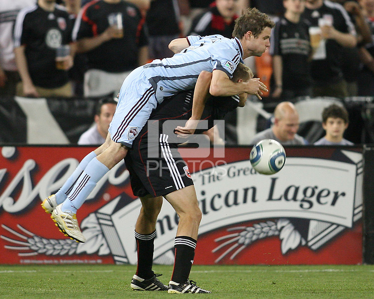 Adam Cristman #7 of D.C. United is caught under Drew Moor #3 of the Colorado Rapids during an MLS match on May 15 2010, at RFK Stadium in Washington D.C. Colorado won 1-0.