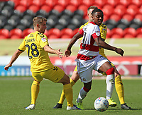 Doncaster Rovers' Niall Ennis gets away from Fleetwood Town's Jack Sowerby<br /> <br /> Photographer David Shipman/CameraSport<br /> <br /> The EFL Sky Bet League One - Doncaster Rovers v Fleetwood Town - Saturday 17th August 2019  - Keepmoat Stadium - Doncaster<br /> <br /> World Copyright © 2019 CameraSport. All rights reserved. 43 Linden Ave. Countesthorpe. Leicester. England. LE8 5PG - Tel: +44 (0) 116 277 4147 - admin@camerasport.com - www.camerasport.com