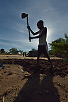 John Ankay, 13, prepares the ground for planting in the Rhino Refugee Camp in northern Uganda. As of April 2017, the camp held almost 87,000 refugees from South Sudan, and more people were arriving daily. About 1.8 million people have fled South Sudan since civil war broke out there at the end of 2013. About 900,000 have sought refuge in Uganda. <br /> <br /> The boy's family fled from Yei, South Sudan, in 2016.