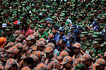 Bangladesh army soldiers, police personnel and firefighters gather at the wreckage of a Bangladeshi garment factory building to offer prayers for the souls of the 1,127 people who died in the structure's collapse last month, in Savar, near Bangladesh, Tuesday, May 14, 2013.