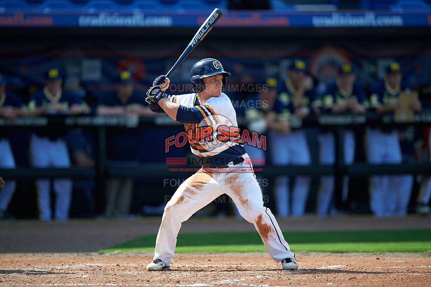 Canisius College Golden Griffins left fielder Tim Kensinger (10) at bat during the second game of a doubleheader against the Michigan Wolverines on February 20, 2016 at Tradition Field in St. Lucie, Florida.  Michigan defeated Canisius 3-0.  (Mike Janes/Four Seam Images)