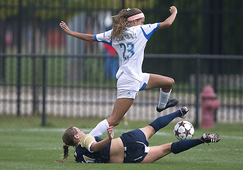 September 01, 2013:  Notre Dame defender Sammy Scofield (11) slides to knock the ball from UCLA defender Ally Courtnall (23) during NCAA Soccer match between the Notre Dame Fighting Irish and the UCLA Bruins at Alumni Stadium in South Bend, Indiana.  UCLA defeated Notre Dame 1-0.