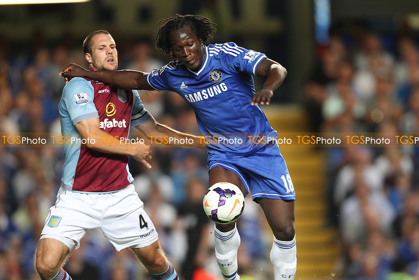 Romelu Lukaku of Chelsea tussles with Ron Vlaar of Aston Villa - Chelsea vs Aston Villa - Barclays Premier League Football at Stamford Bridge, Fulham Road, London - 21/08/13 - MANDATORY CREDIT: Simon Roe/TGSPHOTO - Self billing applies where appropriate - 0845 094 6026 - contact@tgsphoto.co.uk - NO UNPAID USE