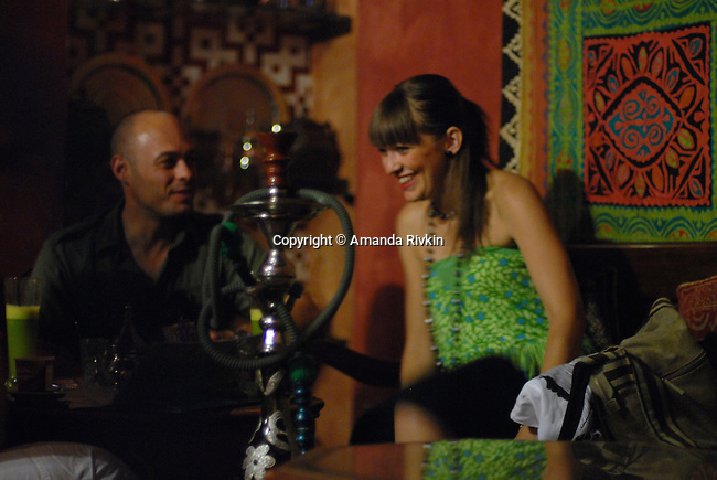 Locals at the Arab-themed Hammam Shisha Cafe in the old Jewish quarter of Cordoba, Spain on July 28, 2007.