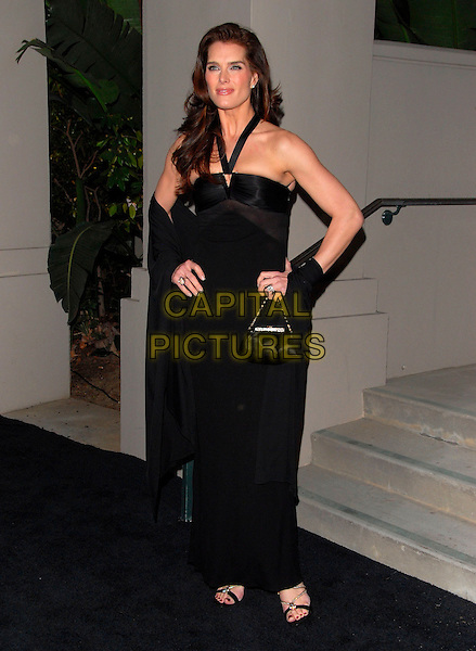 BROOKE SHIELDS.Attends The Rodeo Drive Walk Of Style Award honoring Gianni and Donatella Versace held at The Beverly Hills City Hall in Beverly Hills, California, USA,.February 08 2007..full length black dress gown hand on hips halterneck wrap bag.CAP/DVS.©Debbie VanStory/Capital Pictures