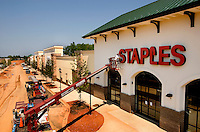07/19/07:  A construction worker installs a sign for a new Staples store during construction/expansion of a Charlotte-area shopping center. The county surrounding Charlotte, NC, is one of the country's fastest-growing areas. ..By Patrick Schneider- Patrick Schneider Photography.