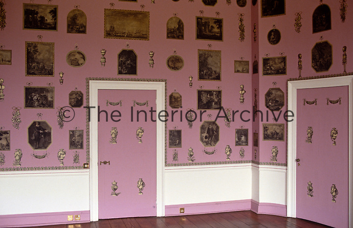 The walls of the print room at Heveningham Hall have been painted an unusual shade of pink