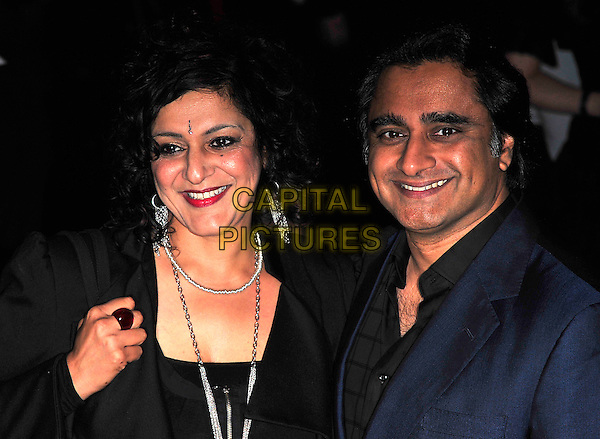 "MEERA SYAL & SANJEEV BHASKAR.The UK Premiere of ""The Imaginarium Of Doctor Parnassus"" at the Empire Leicester Square, London, England..October 6th 2009.headshot portrait black blue suit jacket ring silver necklaces red lipstick married husband wife .CAP/CJ.©Chris Joseph/Capital Pictures."