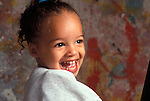 African American preschool student laughing and having fun in art class