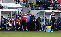 Saturday, 15 March 2014<br /> Pictured: Swansea manager Garry Monk stands dejected (R) after the final whistle.<br /> Re: Barclay's Premier League, Swansea City FC v West Bromwich Albion at the Liberty Stadium, south Wales, UK.