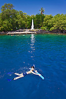 snorkelers and Captain Cook Monument, Kealakekua Bay Marine Preserve, Captain Cook, Big Island, Hawaii, USA, Pacific Ocean, Model Released - MR#: 000106