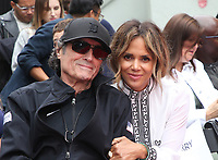 HOLLYWOOD, CA - MAY 14: Ian McShane, Halle Berry, at the Keanu Reeves Hand And Foot Print Ceremony at the TCL Chinese Theatre IMAX in Hollywood, California on May 14, 2019. <br /> CAP/MPIFM<br /> &copy;MPIFM/Capital Pictures