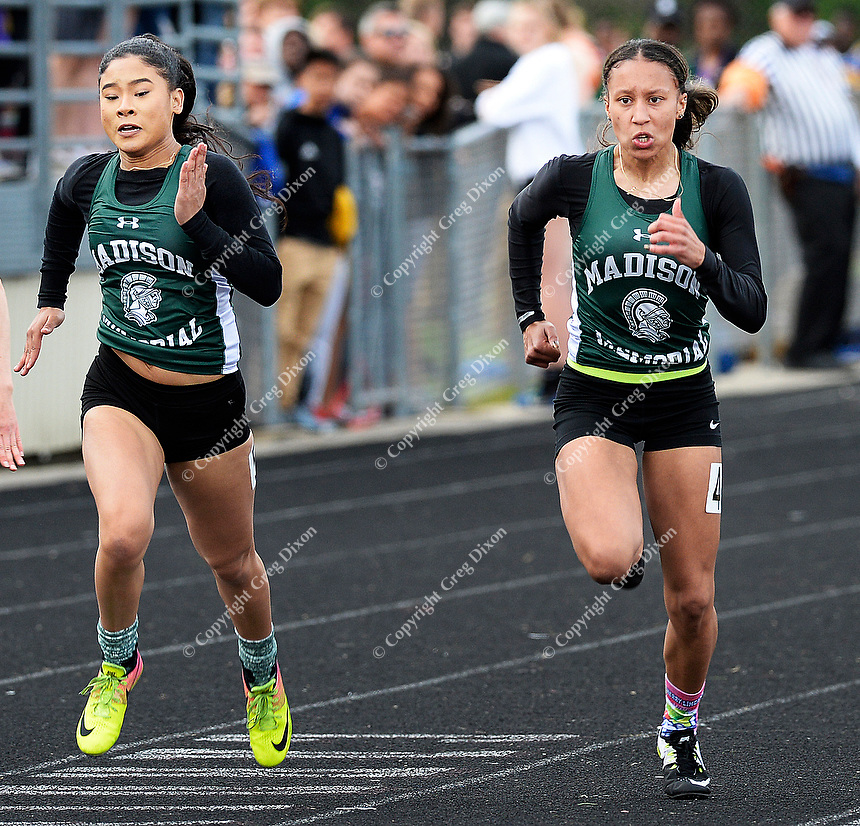 Madison Memorial's Grace Korger-Mitchell (right) and  Micah Wade (left) take first and second in the 100 meter dash during the Wisconsin WIAA Division 1 high school track and field regional on Monday, 5/20/19 at Middleton High School. Korger-Mitchell finishes in 12.48 seconds; Wade, in 12.57 seconds | Wisconsin State Journal article front page Sports 5/21/19 and online at https://madison.com/wsj/sports/high-school/track/madison-memorial-friends-grace-korger-mitchell-micah-wade-up-to/article_9d6b6f79-207c-5ce2-9de0-ab41b493d0d5.html