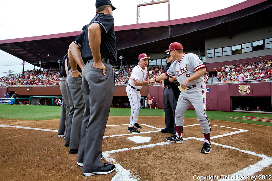 TALLAHASSEE, FL 6/8/12-FSU-STANFORD060812 CH-Florida State Coach Mike Martin, left, wishes Stanford Coach Mark Marquess good luck prior to the first NCAA Super Regional game against Stanford Friday at Dick Howser Stadium in Tallahassee.The Seminoles beat the Cardinal 17-1..COLIN HACKLEY PHOTO