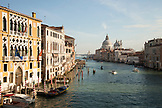 ITALY, Venice.  A view from Ponte dell' Accademia bridge of the Grand Canal. The domes of the Basilica di Santa Maria della Salute can be seen in the distance.