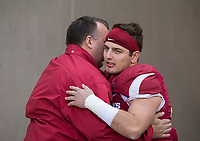 Hawgs Illustrated/BEN GOFF <br /> Bret Bielema, Arkansas head coach, hugs linebacker Karl Roesler during recognition of senior players before the game against Missouri Friday, Nov. 24, 2017, at Reynolds Razorback Stadium in Fayetteville.