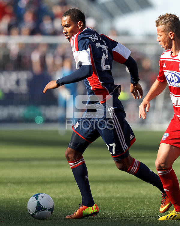 New England Revolution forward Jerry Bengtson (27) dribbles. .  In a Major League Soccer (MLS) match, FC Dallas (red) defeated the New England Revolution (blue), 1-0, at Gillette Stadium on March 30, 2013.