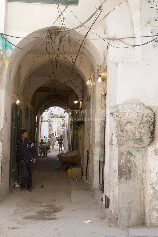 Tripoli, Libya - Roman Column in Tripoli Medina (Old City), incorporated into newer construction.  Street Scene.