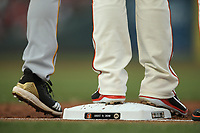 SAN FRANCISCO, CA - AUGUST 11:  Detail of Nike cleats belonging to Buster Posey #28 of the San Francisco Giants standing on first base celebrating the #25 retirement of Barry Bonds during the game against the Pittsburgh Pirates at AT&T Park on Saturday, August 11, 2018 in San Francisco, California. (Photo by Brad Mangin)