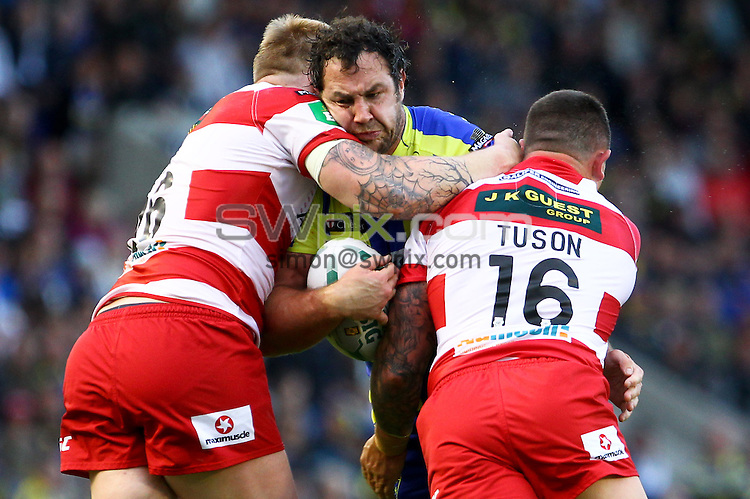 PICTURE BY ALEX WHITEHEAD/SWPIX.COM - Rugby League - Super League - Warrington Wolves vs Wigan Warriors - Halliwell Jones Stadium, Warrington, England - 24/06/13 - Warrington's Adrian Morley is tackled by Wigan's Dom Crosby and Chris Tuson.