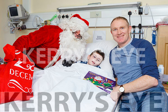 Children from the Cashel Ward in University Hospital Kerry were delighted to Santa stop by on Friday afternoon. Pictured were: Santa with Ger Costello and his 11-year-old son Tadgh from Killorglin.