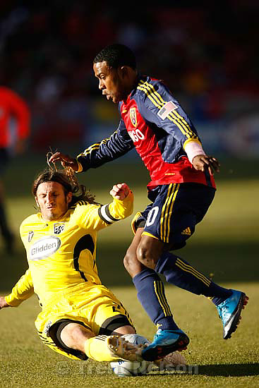 Columbus Crew defender Frankie Hejduk (2) puts the slide tackle on  Real Salt Lake forward Robbie Findley (10). Real Salt Lake vs. Columbus Crew, MLS Soccer playoffs Saturday, October 31 2009 at Rio Tinto Stadium in Sandy.