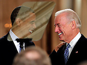 Washington, D.C. - March 23, 2010 -- United States President Barack Obama, left and U.S. Vice President Joseph Biden share a laugh after Biden introduced the President's remarks prior to his signing the version of the health care bill that was passed by the U.S. House of Representatives in the East Room of the White House in Washington, D.C. on Tuesday, March 23, 2010..Credit: Ron Sachs / CNP.(RESTRICTION: NO New York or New Jersey Newspapers or newspapers within a 75 mile radius of New York City)