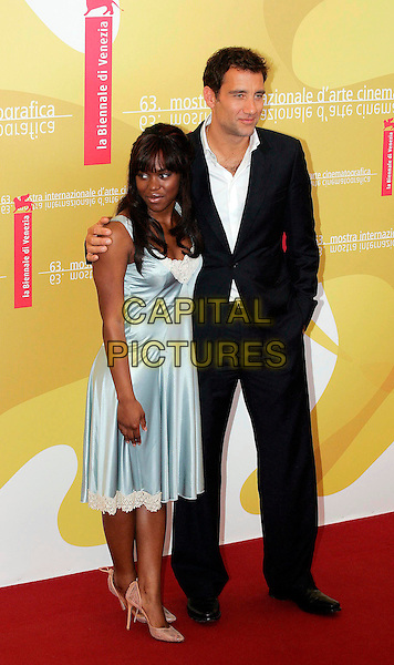"CLAIRE-HOPE ASHITEY & CLIVE OWEN.Photocall for film ""Children Of Men"",.63rd International Venice Film Festival,.Venice, Italy, 3rd September 2006..full length black suit white shirt claire hope clare.Ref: OME.www.capitalpictures.com.sales@capitalpictures.com.©GPA/Omega/Capital Pictures."