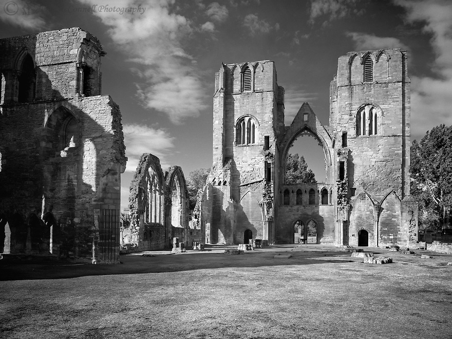 Found in the northeastern part of Scotland in the town of Elgin, is the ruin of Elgin Cathedral.  Established in 1224, the Cathedral suffered from fires in 1270, 1390, and 1402.  After the Protestant reformation of 1560, the Cathedral lost its roof.  A gable wall above the double door contains a large opening that once held a large rose window.  Several other interesting features can be found around the ruins as one explores.