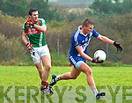Denis Daly of St.Marys wins the ball from Alan Smith of St.Michaels/Foilmore during the South Kerry semi final in Valentia on Sunday.