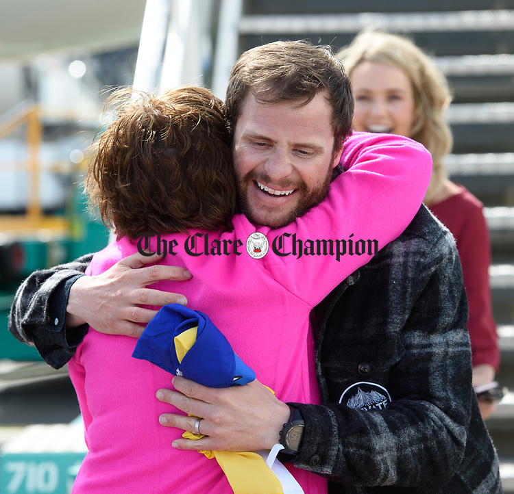 Spanish Point man John Burke, accompanied by his wife Aoibhin Garrihy, is greeted by his mother Claire on his arrival back to Shannon Airport, following his successful attempt, being the first Clare person ever to climb Mount Everest. Photograph by John Kelly.