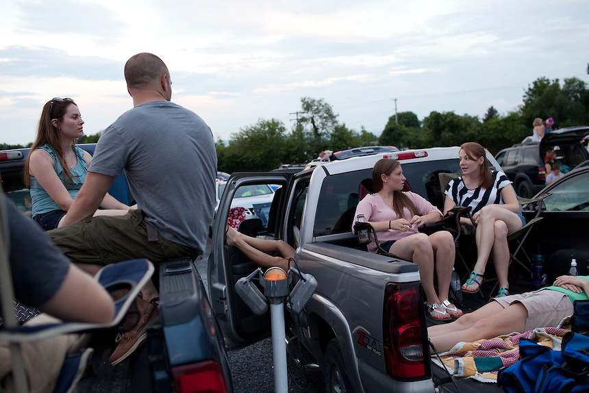 Friends hang out before the movie begins at Family Drive-In Theatre in Stephens City, Virginia on July 20, 2013. From left to right: Brittany Palmer of Mt. Jackson, VA, Billy Paxtion (back turned) of Broadway, VA, Paige Frazier and  her sister Molly Frazier of New Market, VA. CREDIT: Lance Rosenfield/Prime