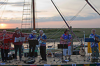 Blakeney, Norfolk, England, 08/08/2009..Sea shanties and folk music on Blakeney harbour front.