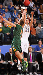 BROOKINGS, SD - JANUARY 25:  Chad White #25 from South Dakota State University spots up for a jumper over Mike Felt #3 from North Dakota State University in the first half of their game Saturday afternoon at Frost Arena in Brookings. (Photo by Dave Eggen/Inertia)