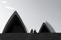Two children seated on the steps of the Sydney Opera House.