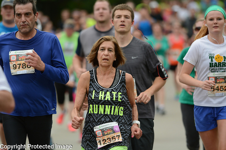 Barbara Tuttle stands out amongst the runners during the Bellin Run in Green Bay, Wis., on June 13, 2015.