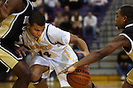01 December 2006--Warren Central at Marion Boys Basketball. Marion's Jay Edwards tries to work his way between two Warren Central defenders Friday night. PHOTO/Daniel Johnson dhjohnson@marion.gannett.com