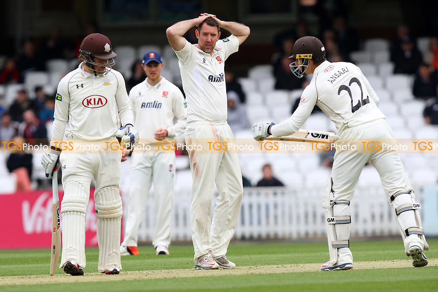 Frustration for David Masters of Essex as Rory Burns (L) and Zafar Ansari add to the Surry total - Surrey CCC vs Essex CCC - LV County Championship Division Two Cricket at the Kia Oval, Kennington, London - 26/04/15 - MANDATORY CREDIT: Gavin Ellis/TGSPHOTO - Self billing applies where appropriate - contact@tgsphoto.co.uk - NO UNPAID USE