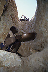 Gold mining  on the plains of Northern Turkana. Children do much of the hard labour and panning