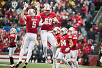Wisconsin Badgers teammates Garret Dooley (5) and Tyler Johnson (59) celebrate during an NCAA College Big Ten Conference football game against the Michigan Wolverines Saturday, November 18, 2017, in Madison, Wis. The Badgers won 24-10. (Photo by David Stluka)